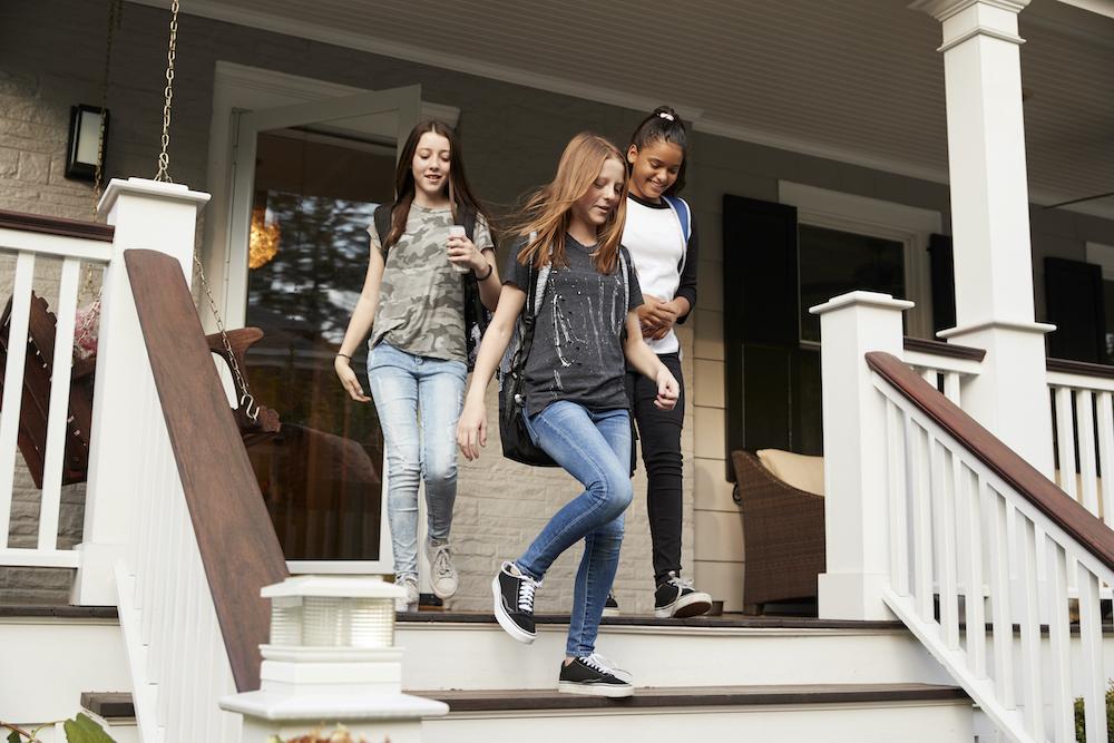 Teen girls walking down steps